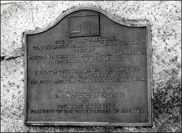 The memorial plaque on the monument at the Marconi Station at Wellfleet in Cape Cod, MA. Site of first American Transatlantic radio telegraph station built by Marconi Wireless Telegraph Company of America, predecessors of R.C.A. in 1902.