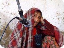 Sita Shahi singing at mic