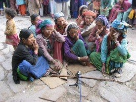 Recording women, sitting around a microphone