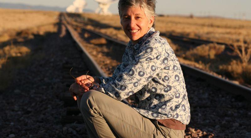 Neenah Ellis, siiting on a railroad track