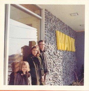 Three Ellis kids in front of their parents' radio station, 1965, just after the station went on the air. Neenah, age 11, in the middle. Neenah's brother, Leigh (on the right) runs the station now.