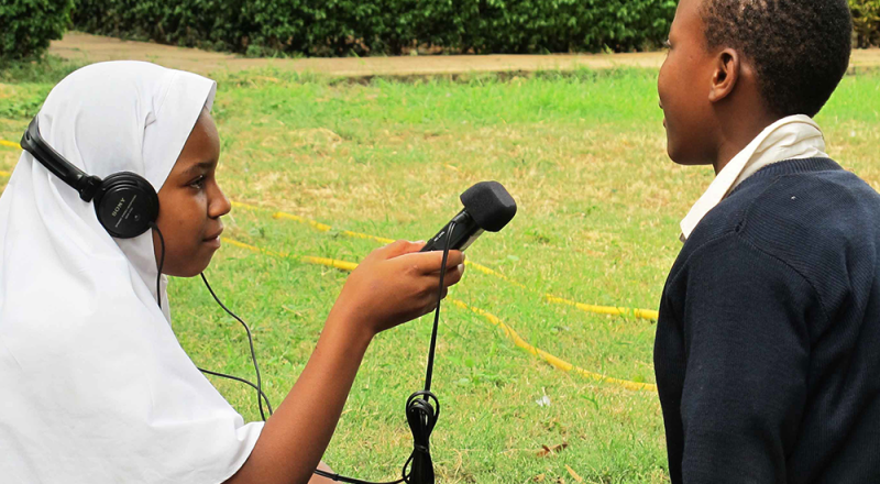 Youth radio producers from the Zanzibar Association for People Living with HIV/AIDS record an interview for their weekly youth radio show on Zenji FM
