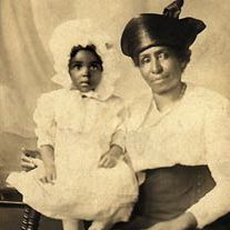 Elizabeth Evans, left, sits with her grandmother Betty Moore in this photograph taken around 1917 or 1918.