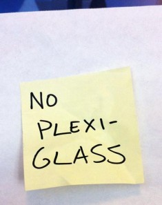 Poster board note: No Plexiglass