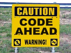 Warning sign reads: Code Ahead