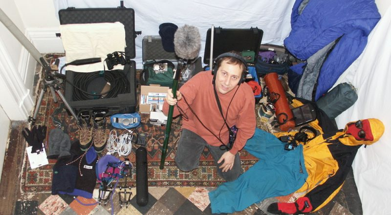 Science reporter Daniel Grossman surrounded by his field recording gear.