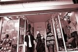 James Carter, Jada Watson, and Mr. Dorsey, in front of Dreams Boutique