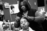Tiffany Thomas styles a client at Shear Intensity Hair Salon