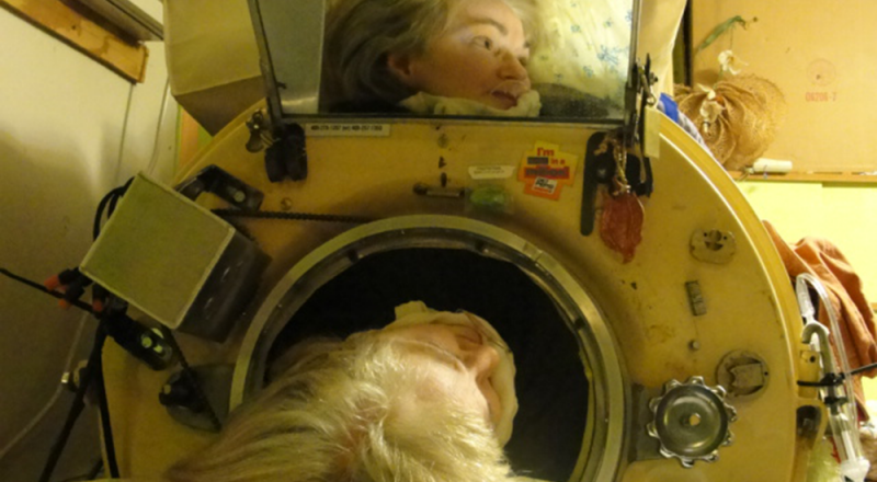 """Martha Lillard inside her """"iron lung."""" Lillard contracted polio when she was six and needs the """"lung"""" to breathe. (Photo by Julia Scott)"""