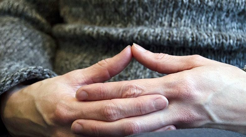 Hospice workers: closeup of hands