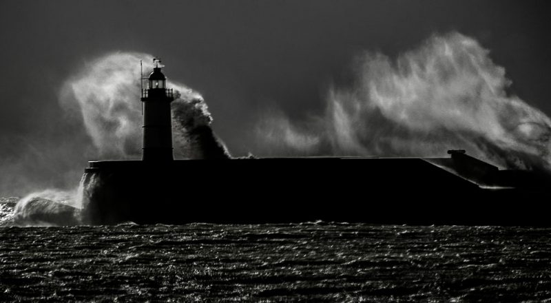 photo of a lighthouse in a storm