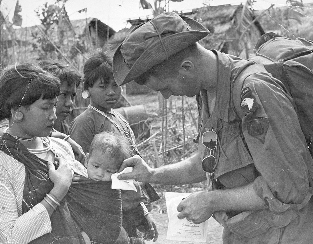 An unidentified soldier with locals. Photo by Earl Van Alstine