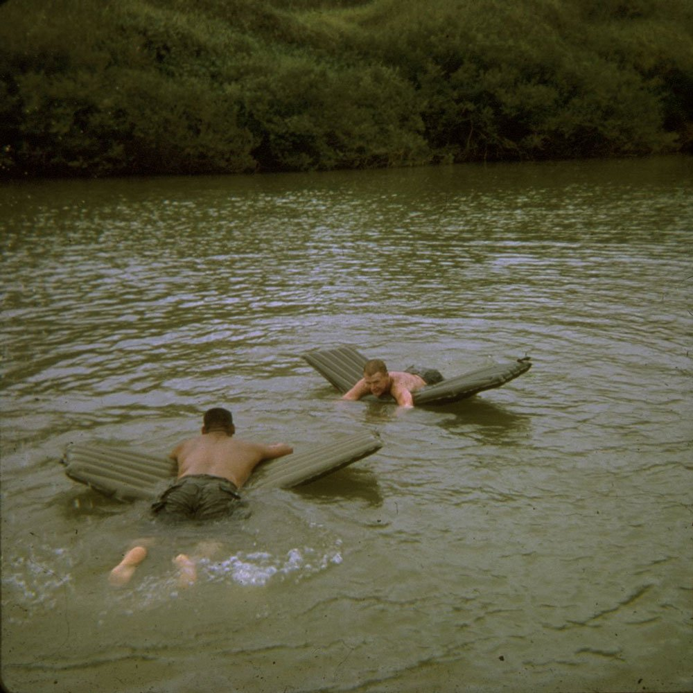 Ray Palmer on raft (facing camera). Photo by Dave Dillard
