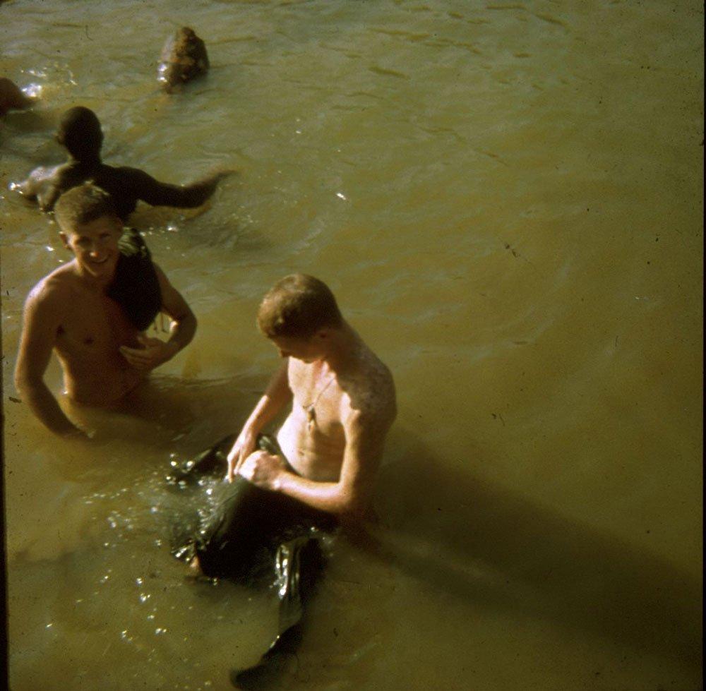 Ray Palmer (facing camera) with Dennis Moore washing his shirt.
