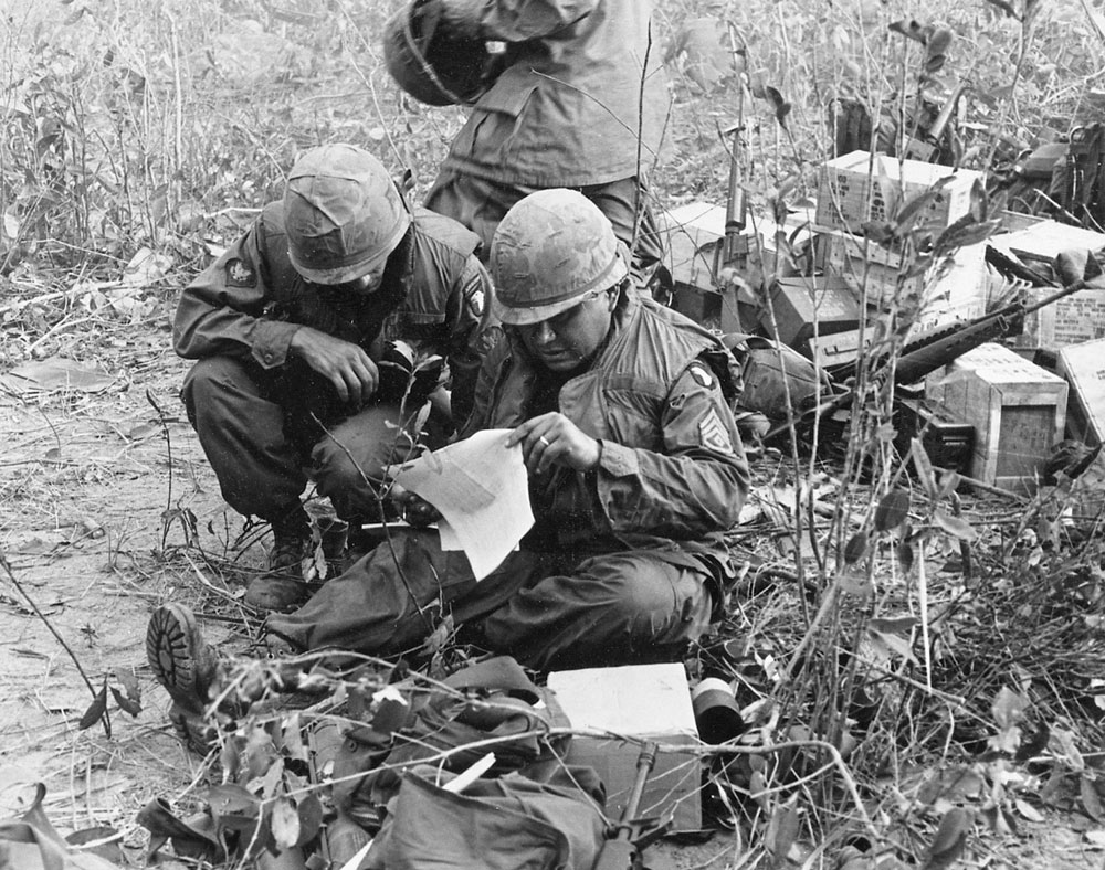 "Delta First Sargent Austin ""Amor"" Harjo reviews the company roster as he tries to tally those Killed in Action, Wounded in Action and evacuated the morning of March 19th. Photo by Earl Van Alstine"