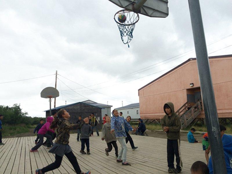photo of kids playing basketball