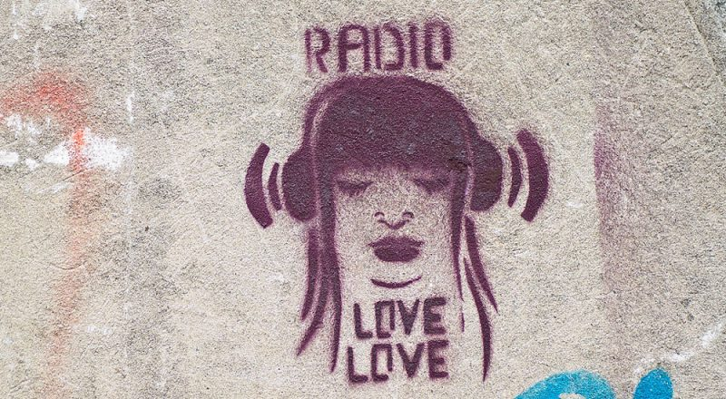 graffiti of woman wearing headphone