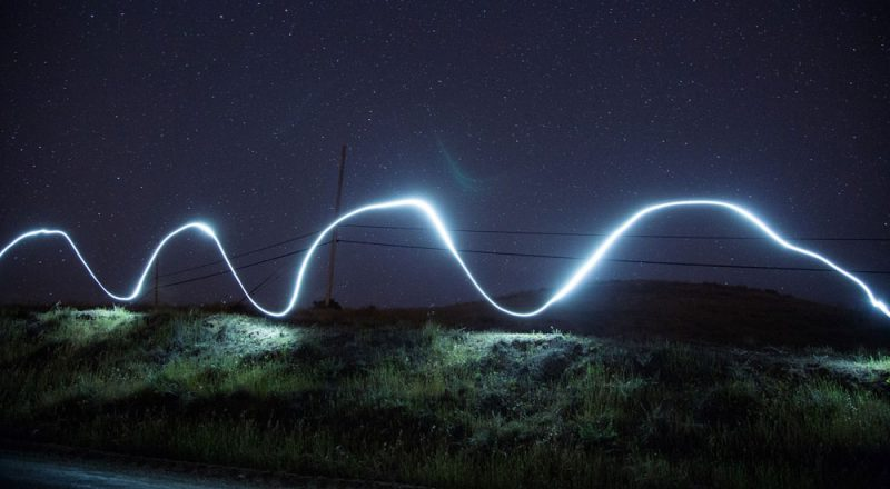 image of sound wave against night sky